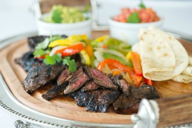 FAJITAS WITH MARINATED GRILLED FLANK STEAK, GUACAMOLE, SALSA, AND WARM TORTILLAS!
